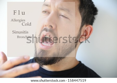 young man about to sneeze into his hand - stock photo