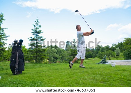Young man after golf strike on course.