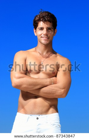 young man against a sea background