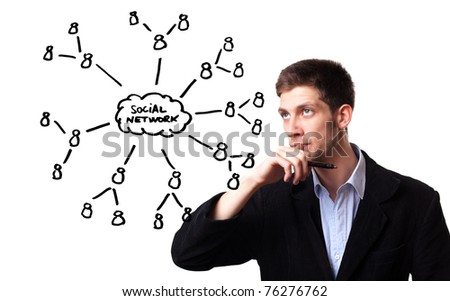 Young man analysing social network schema on the whiteboard - stock photo