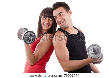 Young man and a woman team training with dumbbells - stock photo