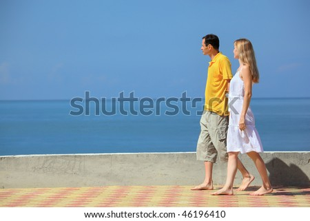 young man and beautiful woman on quay - stock photo