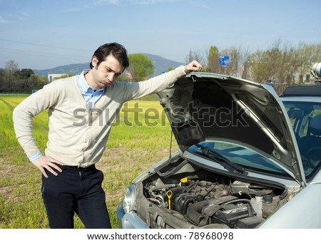 young man and car beakdown - stock photo