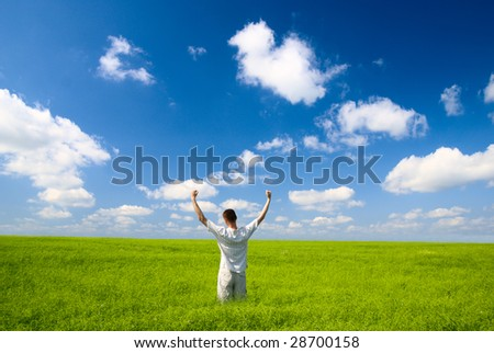 young man and field of green grass