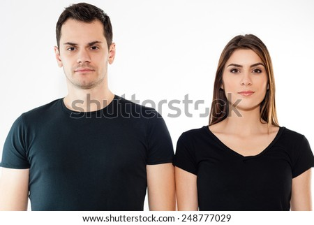 young man and girl in black T-shirts isolated on white background - stock photo