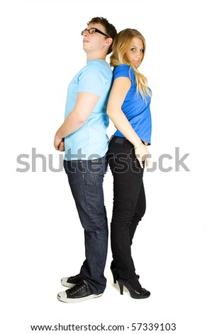 young man and girl in blue shirt standing back to back isolated on white