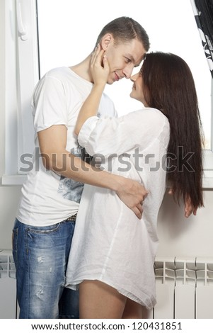young man and girl look at each other and smiling - stock photo