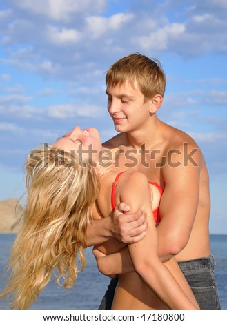 Young man and girl on the seacoast