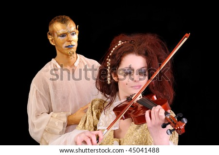 Young man and girl playing violin with faces artistic painted