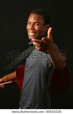 Young man and guitar lending a hand - stock photo