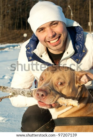Young man and his dog - man's best friend - stock photo