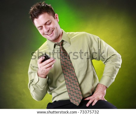 Young man and his smart phone - stock photo