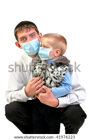 young man and kid in the flu mask - stock photo