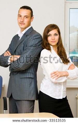 Young man and lady in their office