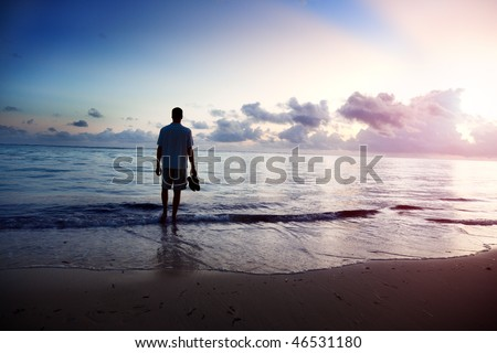 young man and sunset on sea - stock photo