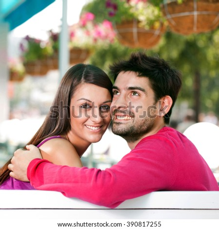 young man and the act of women on a romantic date in a cafe - stock photo