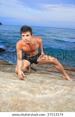 young man and water of ocean