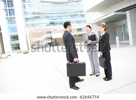 Young man and woman business team at office building - stock photo