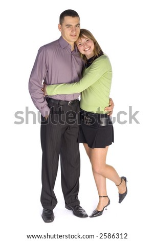 Young man and woman cuddling up to eachother. Isolated on white in studio.