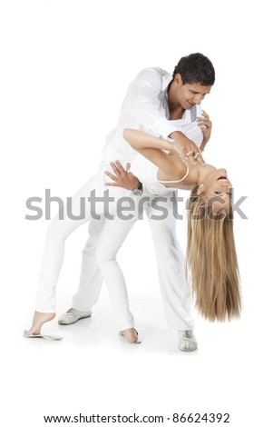 Young man and woman dancing and have fun - stock photo