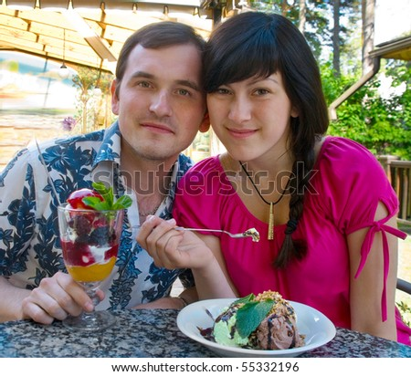 Young man and woman eating ice-cream