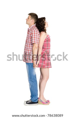 Young man and woman facing each other back in full growth. - stock photo