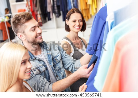 Young man and woman going shopping together - stock photo