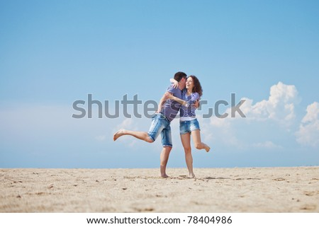 Young man and woman have a rest at the sea