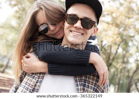 Young man and woman have fun on street.