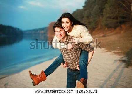 Young man and woman having fun outdoor in spring - stock photo
