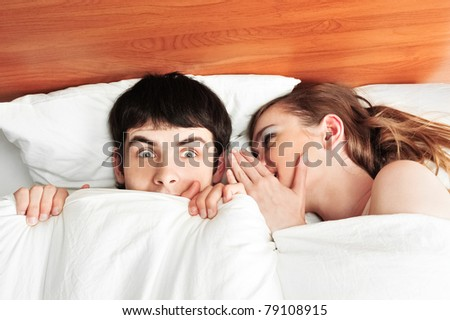 Young man and woman in bed. Couple.