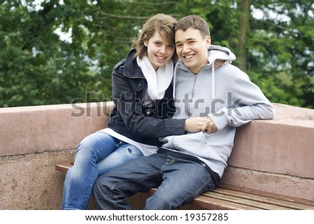 young man and woman in love for the first time. - stock photo