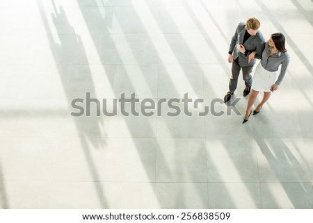 Young man and woman in the office - stock photo