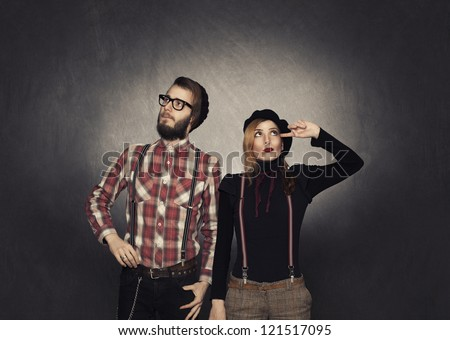 young man and woman nerds thinkin on grunge background - stock photo