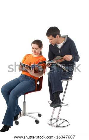 Young man and woman reading magazines isolated