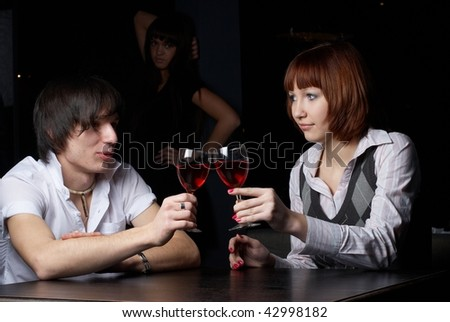 Young man and woman sitting in cafe