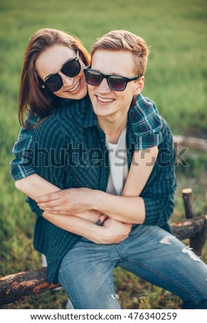 Young man and woman together on countryside. Close up