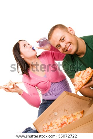 Young man and young woman eating pizza - stock photo