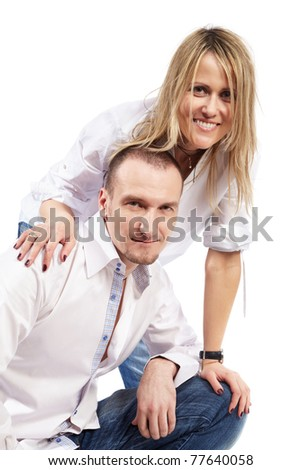 Young man and young woman in white shirts and blue jeans.