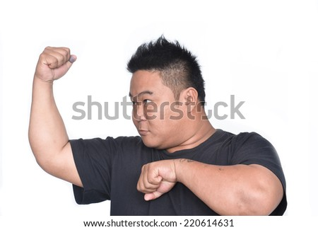 young man angry gesturing fist raised menacing threat studio portrait on isolated white background