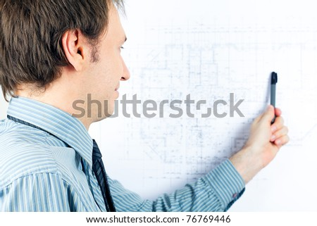 young man architect presenting a project - stock photo