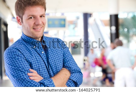 young man arms crossed