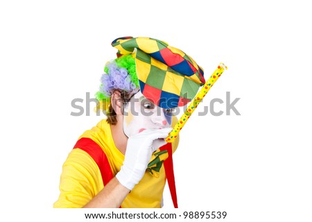 Young man as a clown with whistle - stock photo