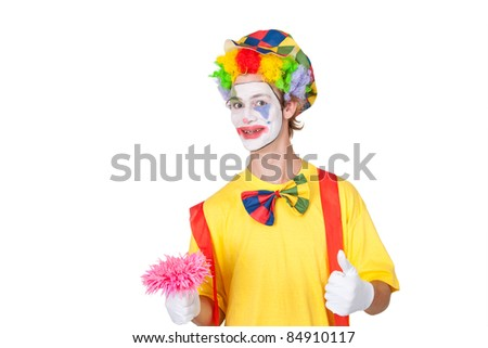 Young man as clown with pink plastic flower - isolated