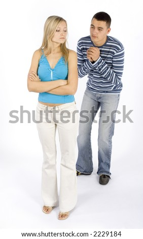 young man ask young woman for forgiveness - stock photo