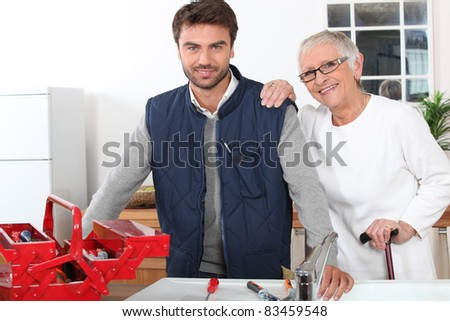 Young man assisting old lady - stock photo