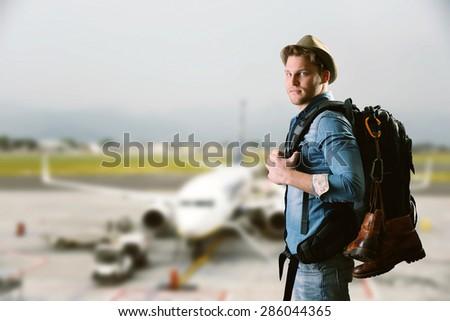 young man at airport - stock photo