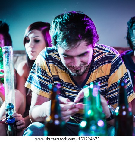 young man at party doing drugs - stock photo