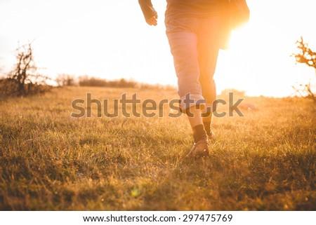 Young man at sunset - stock photo