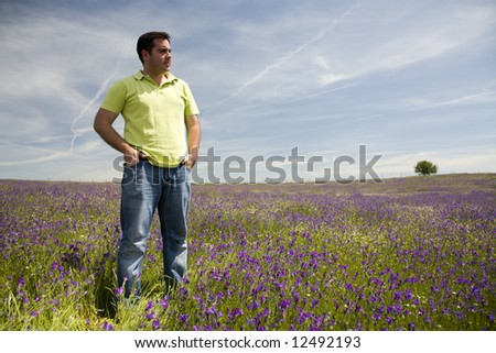 Young Man at the blooming meadow - stock photo